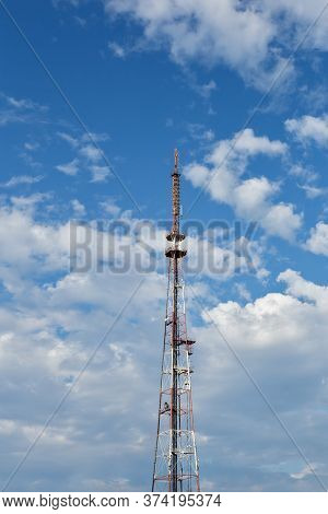 Irkutsk, Russia - June 26 2020: White And Red Tv Tower On Blue Sky With Clouds