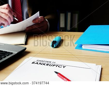 Chapter 11 Bankruptcy Papers On The Manager Desk.