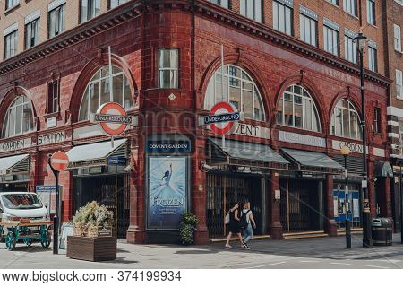 London, Uk - March 06, 2020: Two Women Walking Outside Closed Covent Garden Station In London, Motio