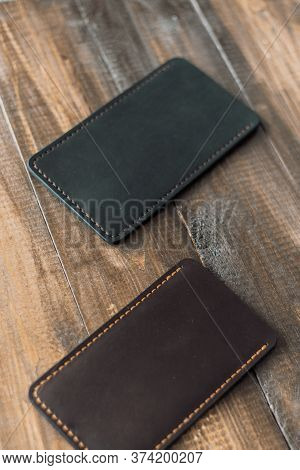 Leather Luxury Phone Cases On A Wooden Background. Beautiful Genuine Leather Phone Cases.