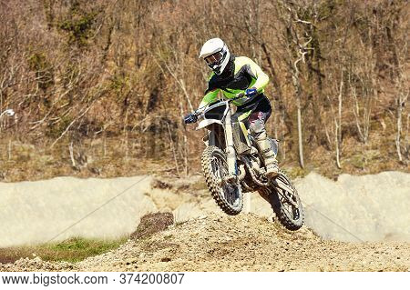 Motocross Concept, A Biker Goes Off-road Making Extreme Skiing. In Pursuit Of Adrinalin, Sport Conce