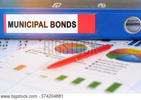 On The Table Are Pie Charts, A Pen And A Folder With The Inscription - Municipal Bond. Business And