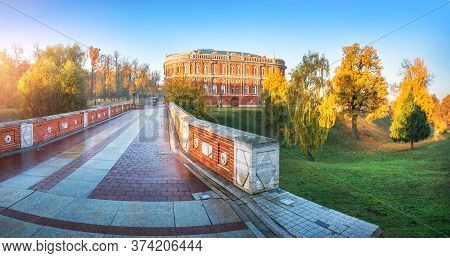 View Of The Bridge Over The Ravine And Buildings In Tsaritsyno Park In Moscow In The Early Autumn Su