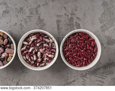 Three Kinds Of Beans In Round Bowls. The View From The Top.