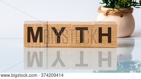 Myth Word Written On Wood Block. Myth Text On Table, Concept. The Inscription Is Reflected, In The B