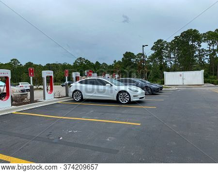 Vero Beach, Fl/usa-6/6/20:  Cars Charging At A  Tesla Supercharger Station In Florida.