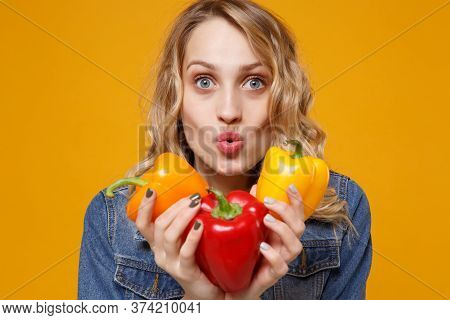 Amazed Young Woman In Denim Clothes Isolated On Yellow Orange Background In Studio. Proper Nutrition