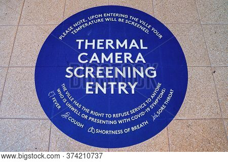 Townsville, Queensland, Australia - June 2020: Thermal Camera Screening Entry Sign In Foyer Of Hotel