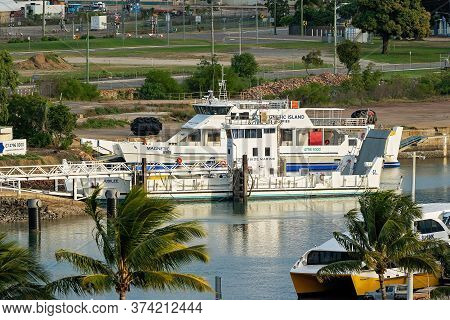 Townsville, Queensland, Australia - June 2020: Tour Boat And Barge Moored At City Jetty Waiting For