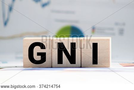 Wooden Blocks With The Word Gni And Up Arrow. Gross National Income Is The Sum Of A Nation's Gross D