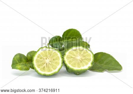 Cut Half Bergamot, Kaffir Lime, Leech Lime Or Mauritius Papeda With Leaf Is A Vegetable And Herb Of