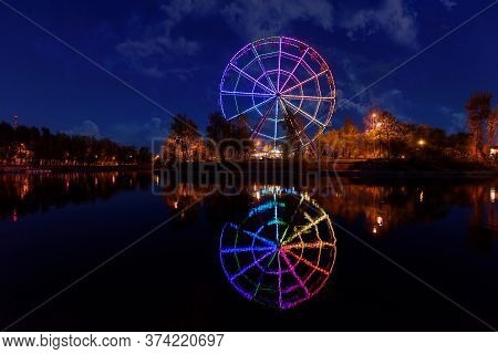 Colorfull Abstract Ferris Wheel With Reflection On The Konny Island In Irkutsk City