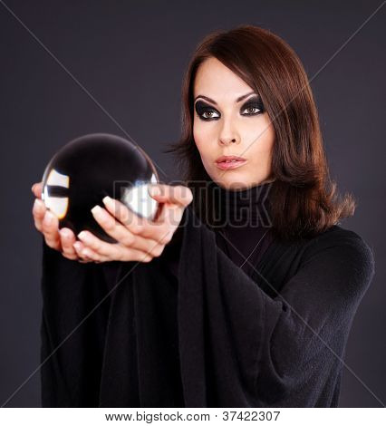 Young woman holding scrying ball