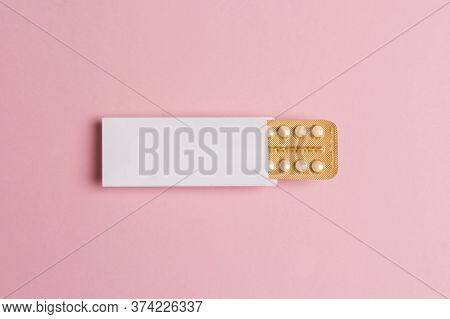 Female Oral Contraceptive Pills Blister On Pink Background. Women Contraceptive Hormonal Birth Contr