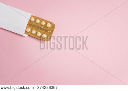 Female Oral Contraceptive Pills Blister With Copy Space On Pink Background. Women Contraceptive Horm