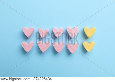 Flat Lay Composition With Marshmallow Hearts On Light Blue Background. Pareto Principle Concept
