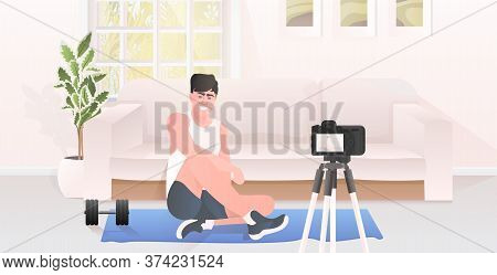 Male Fitness Trainer Recording Video Blog Using Camera On Tripod Live Streaming Social Media Network