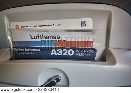 FRANKFURT AM MAIN, GERMANY - CIRCA JANUARY, 2020: close up shot of a seat at an Airbus A320 operated by Lufthansa.