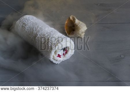 Wet Hot Towel. Steam From The Towel. Bath, Aromatherapy, Spa Care. Spa With The Smell Of The Sea.