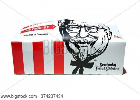 Lake Forest, CA / USA - June 30, 2020: Kentucky Fried Chicken to go meal with Fried Chicken, Coleslaw, and Buttermilk Biscuit. Isolated on white. Editorial use.