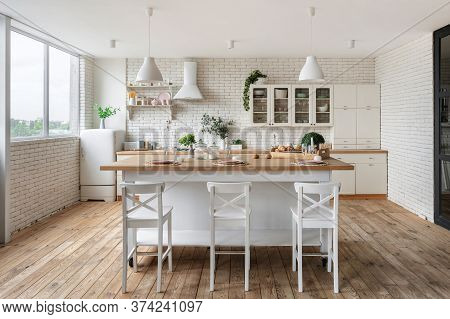 Tableware On Dining Table, Kitchenware Supplies On Shelves, Green Plants On Cupboard Furniture And R