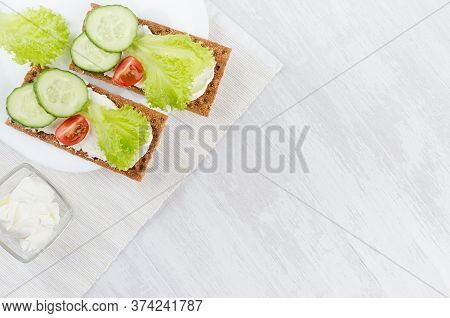 Fresh Summer Healthy Appetizer Of Whole Grain Rye Crisps Breads With Vegetables - Green Salad, Cucum