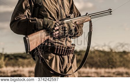 Hunter Man. Hunting Period, Autumn Season. Male With A Gun. A Hunter With A Hunting Gun And Hunting