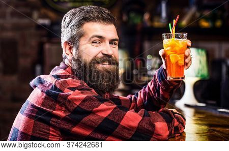 Bearded Man Cocktail. Portrait Man, Drinking Orange Juice. Barman In Pub Or Restaurant. Cheerful Bea