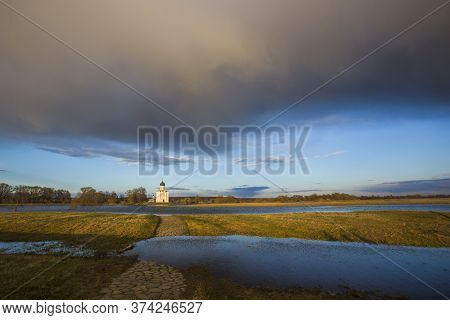 Flooded Way To The Church Of The Intercession On The Nerl. Vladimir Region, Russia. Spring Landscape