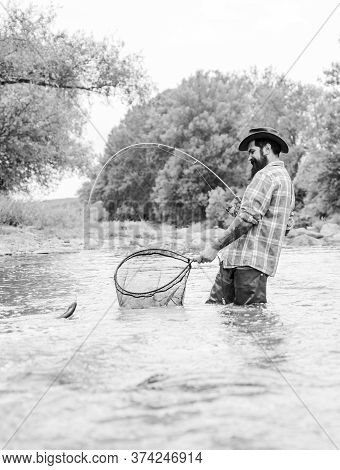 Off Limits Fishing. Bearded Fisher In Water. Mature Man Fly Fishing. Man Catching Fish. Hobby And Sp