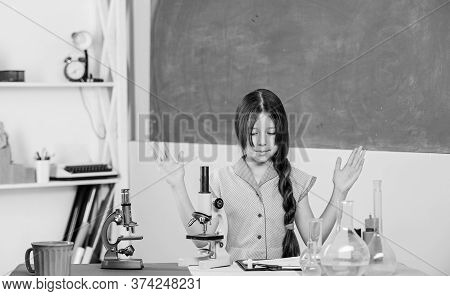 Small Girl With Microscope. Girl Biology Class Testing Tubes. Science Lesson. School Laboratory. Sci
