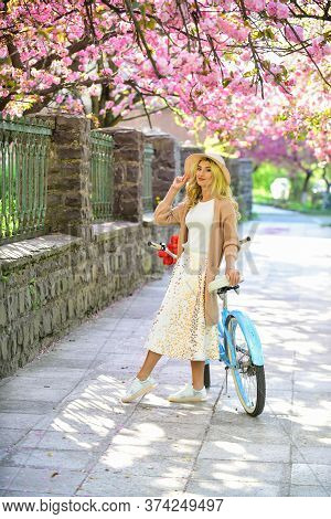Travel Concept. Riding Bicycle. Girl And Sakura Blossom. Summer Vacation. Cycling Tours. Bike Ride A