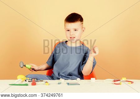 Pediatrician Intern. Little Boy In Medical Uniform. Treatment Prescription. Nurse Laboratory Assista