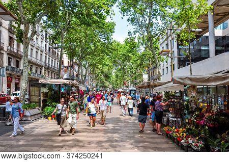 People Walking On La Rambla (central Street Of Barcelona), Spain - June 2019