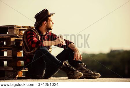 Farmer Drink Alcohol Enjoy View From His Farm. Watching Sunset. Farmer Cowboy Handsome Man Relaxing