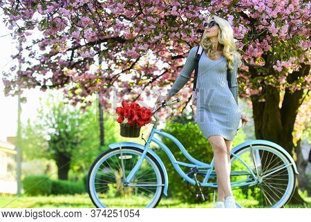 Weekend Concept. Spring Holidays. Riding Bicycle. Girl And Sakura Blossom. Cycling Tours. Excursion