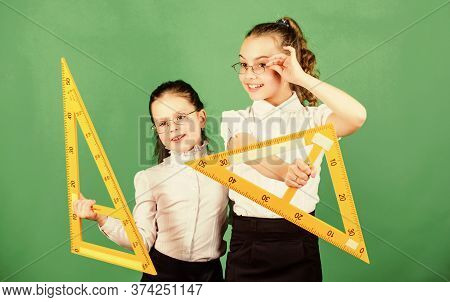 School Students Learning Geometry. Pupil Cute Girls With Big Rulers. Small Girls Back To School. Ste