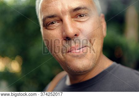 Caucasian Mature Middle Aged Man Smoking Cigarette Outdoors. Nicotine Addiction. Copy Space