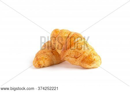 Delicious, Fresh Croissants On A White Background. Croissants Isolated. French Breakfast