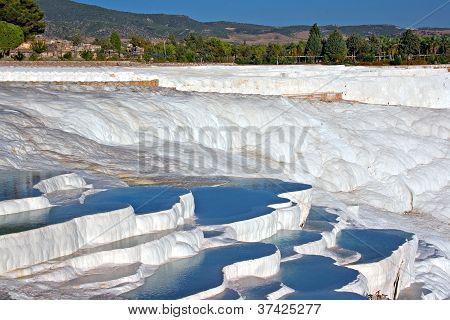 Travetine covered hills and rock pools of Pamukkale Turkey poster