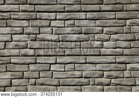 Brick Wall Texture, Background In Grey, Faded Color. Masonry-style Concrete Wall. Stylish Fencing, M