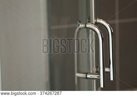Stainless Steel Handle Of Glass Doors In The Shower Room. The Image Is Partially Clear.