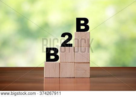 Wooden Cube Block Shapes As Step Stairs With B2b Business To Business Word. Business Concept, Succes