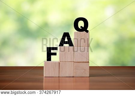 Wooden Cube Block Shapes As Step Stairs With Faq . Help Concept, Frequently Asked Questions