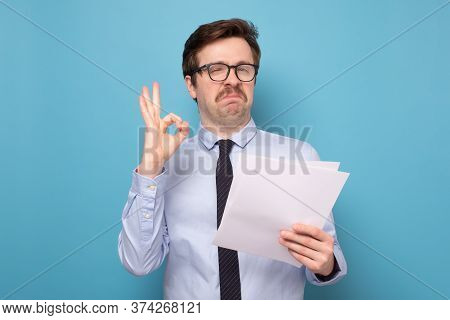 Happy Overjoyed Business Man Read Great News In Documents