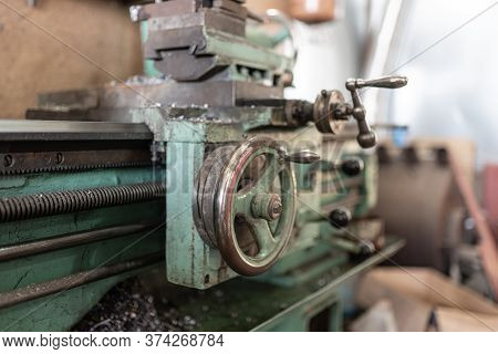 The Old Lathe Machine Is Painted Green. A Small Workshop For Metal Processing. Screw Turning Machine