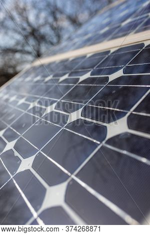 Old Small Solar Panels Gate House Opening Photovoltaic Electric System For Home In The Garden.