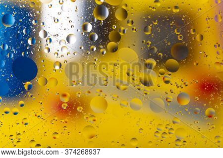 The Abstract Composition With Oil Drops In Water. Yellow Main Color.