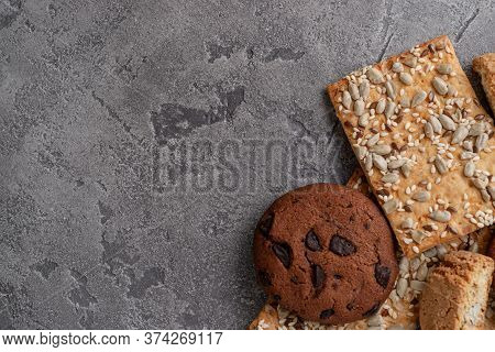 Cookies With Cereal And Sunflower Seeds. Dark Cookies With Chocolate In Right Down Corner. Many Empt