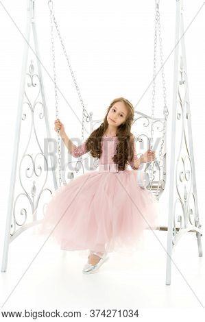 Portrait Of Beautiful Preteen Girl Swinging On Elegant Metal Swing Isolated On White Background. Cha